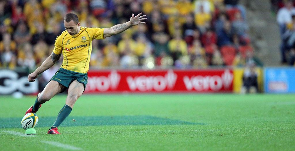 Quade Cooper kicks for goal.