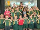 Class 3 pupils from Waraburra State School at the recycling centre in Dooley St.