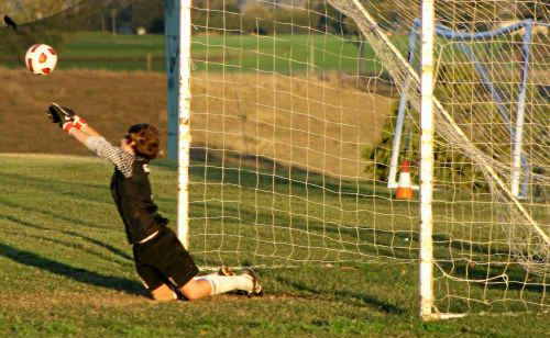 GOALKEEPER JACK GODLEY makes a vital save in the penalty shootout to win the match for the Gatton Redbacks.