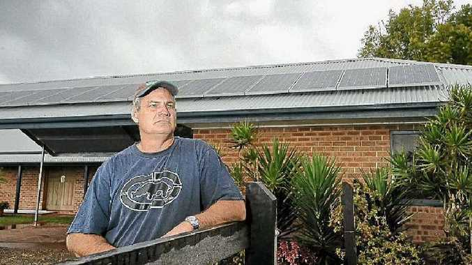 Tony Weir, of Brushgrove, with the 16 solar panels which cost him more than $17,000 to install.