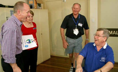 HAPPY DAYS: Campbell Newman shares a laugh with Mackay Meals on Wheels' president Nancy Foyle and volunteers Ken Drury and Tony Charlesworth.