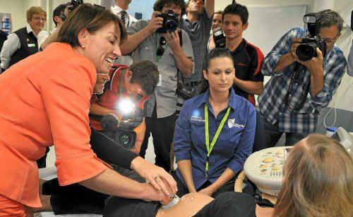 A media scrum as Anna Bligh performed an ultrasound scan on Tamasine Kiln.