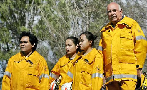STRIKING BACK: Trained rural firefighters Jazper, Zarah and Zola Ojacastro stand alongside Larry Coleman, who says the three are among 15 current volunteers who are under-utilised by a rural fire service that would benefit greatly from a Rockhampton-based brigade.