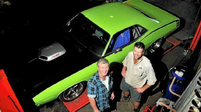 Brett Curran (left) and Michael Middleton put the finishing touches on Mr Curran's 1970 Plymouth Cuda ahead of the Pittsworth Sprints.