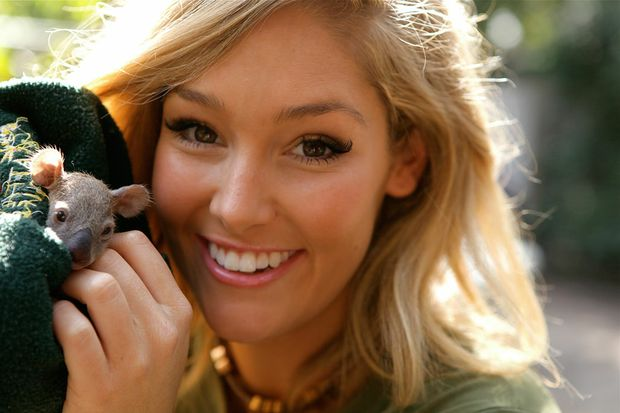 Erin McNaught poses with baby koala Allira at Featherdale Wildlife Park in Sydney.
