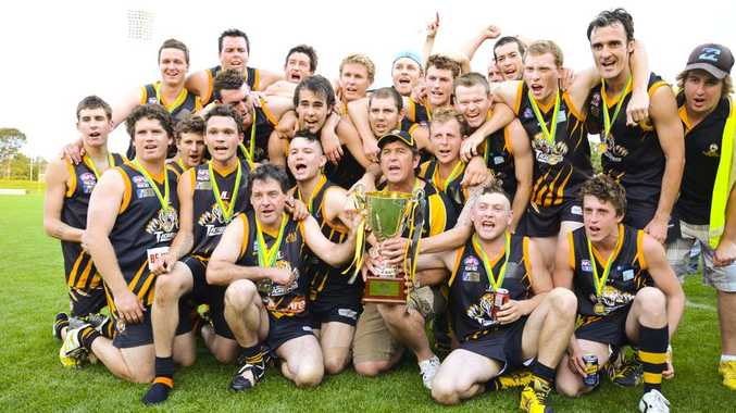 The victorious Grafton Tigers celebrate their grand final in the North Coast AFL competition with a 70-55 win over the Port Macquarie Magpies. Photo: NICKY FLETCHER