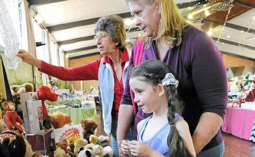 Morgan and Diane Hillyard look at the dolls and bears on show at the fair.