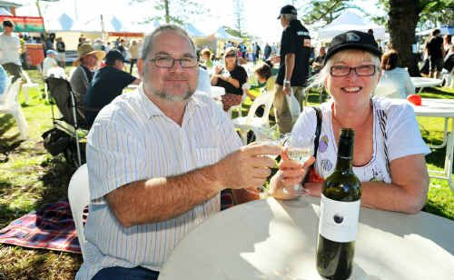 Urunga locals John and Lynley Mitchell join the massive crowds at Toast Urunga.