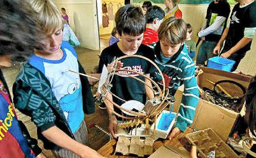 Kids get creative and make sculptures in the eco-craft pavilion at the energy festival.
