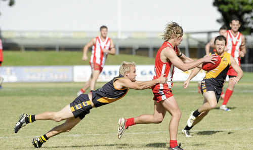 Tweed Coast Tigers player Liam Spence tackles Swans player Rohan Hindry at Oakes Oval during the Summerland League grand final yesterday.
