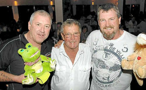Special guests at Saturday's Variety Club dinner were Peter Somers (left) and Todd Russell (right), with the event's co-ordinator John Riordan (centre). The men hold some toys for the silent auction.