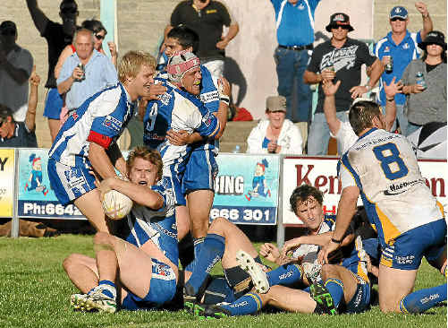 Grafton Ghosts Aaron Hartmann is congratulated after crossing for a try during yesterday's grand final win over Murwillumbah.