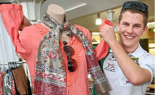 Matthew Zappone raises his mannequin's sleeves in a victory salute after winning the Ready, Steady, Style competition.