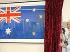 Governor-General Quentin Bryce unveils the flood flag at the Lockyer Valley Cultural Centre.