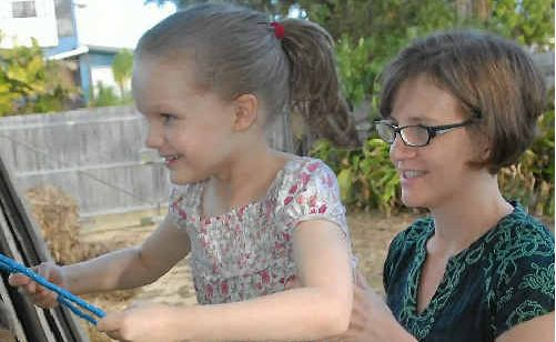 Lucy and her mother, Helen Dimond, enjoy the fun of childhood, like playing on the backyard swing.