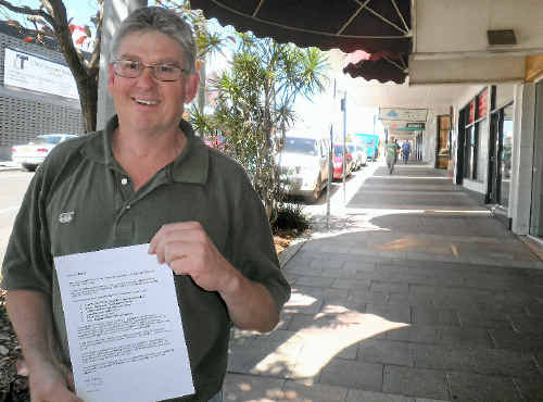 Robert Hall, holding his CV on Goondoon St, is doing everything he can to score a job in the resources sector.