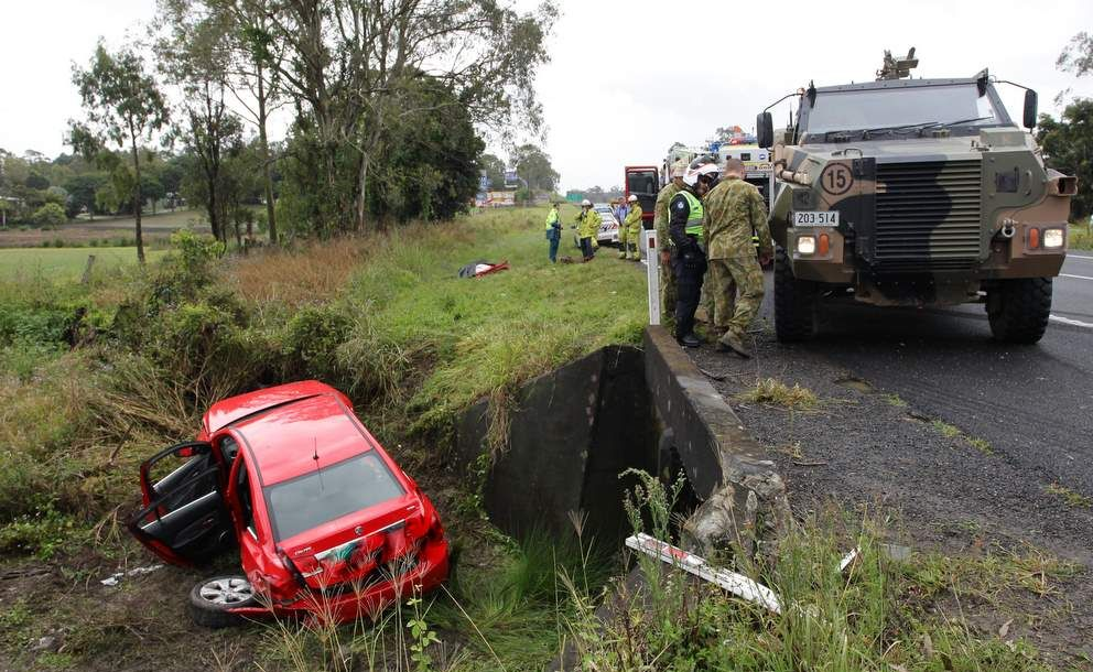 A Red Holden Cruze and an Army Personnel Carrier crashed North Bound on the Bruce Highway at Glenview. Photo: Cade Mooney / Sunshine Coast Daily