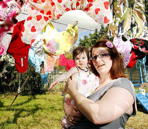 Mother of three Samantha Smith prefers to use cloth nappies. Samantha believes they are better value than disposable nappies and are not as damaging to the environment which her baby daughter Kiara Mulligan (photographed here) will inherit.
