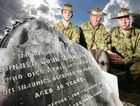 41 Battery 1RAA members Gunner Dale Rettke, Warrant Officer Class Two Keith McCoombes and Captain Andrew Kendall inspect the grave of gunner John J. Hayes at Ipswich Cemetery. The soldier was killed in 1892.