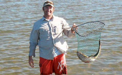 Jeremy Kipping used his bare hands to trap this flathead.