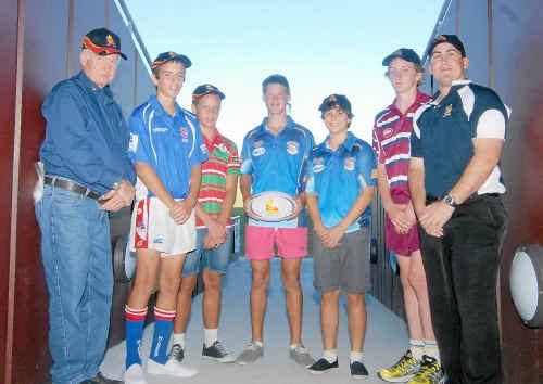 The CQ NRL Bid's Ken Weir, left, and Walson Carlos, right, with players Martin Mare, Reuben Cotter, Kalyn Ponga, Joshua Curti and Joshua Morton at Virgin Australia Stadium.