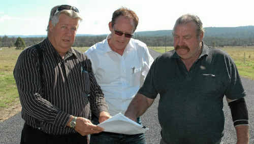 WAR ON WATER: Helidon developer Hans Nan (right) shows Lockyer MP Ian Rickuss (left) and Shadow Minister for Water and Utilities Steve Dickson a bill for water not being used at the new estate.
