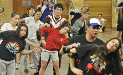 Students show off some dance moves at the It's Your Choice Have a Voice hip-hop dance event at South Grafton High School.