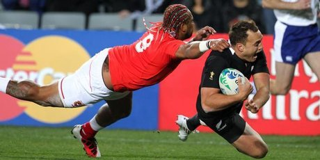 All Black fullback Israel Dagg eludes Tonga halfback Taniela Moa to score during last night's World Cup opener at Eden Park.