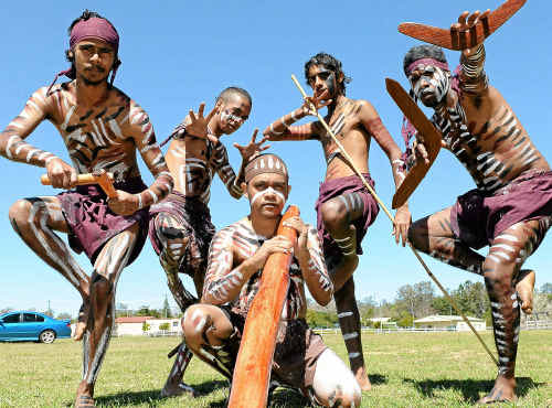 Ma-Mu dancers Rohan, Glen, Andrew, Ashton and Jordan Miller perform a traditional indigenous dance at the Didgeridoo Festival at the Gin Gin showgrounds.