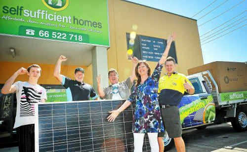 Mark McClurg (second from right) gives away the solar panel package to Sally-Anne Ikin and her family.