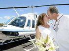Julie and John Hill chose to tie the knot 500 feet above Byron Bay light house in a Bell Jetranger helicopter yesterday.