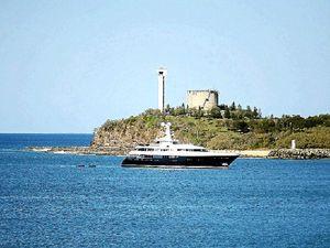 Luxury yacht anchors off Coast