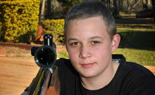 Fourteen-year-old Aaron Smith with his Anschutz 1913 BR 50 Target Rifle and Weaver scope.