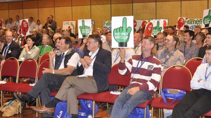 A room full of dairy farmers express their anger over Coles lowering its supermarket-brand milk prices at the Queensland Dairyfarmers' Organisation's conference today.