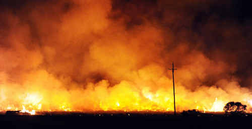 Sugar cane burns west of Maryborough amid fears profits from the crush will suffer the same fate.