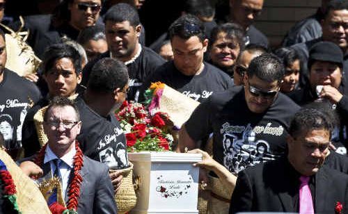 Jeremiah Lale (bottom right) leads the funeral procession for his wife Teukisia and five children Jerry, Paul, Lafoa'i, Sela and Richie. Teukisia and the children were tragically killed in a house fire.