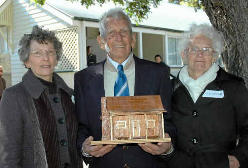 OLD SCHOOL VALUES: The grandson of the founding principal of Flagstone Creek State School, Percival Duke, was presented with a model of the original school building at the schools 125th anniversary on the weekend. From left: daughter Yvonne Duke, Percival Duke and Del Grech.