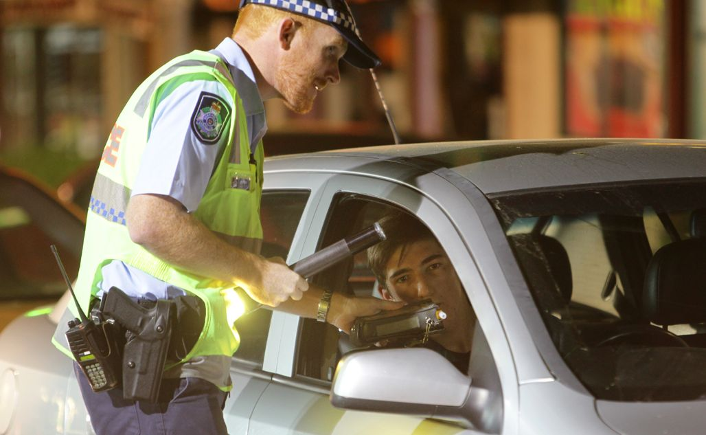 A motorist is stopped by police during Operation Lasso on the Bruce Hwy.