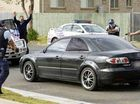 Police pounce on the vehicle of now-convicted armed offender Barry John Rea at Redbank Plains on June 2.