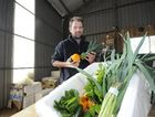 Munch Crunch Organics owner Alasdair Smithson packs produce for his online customers.