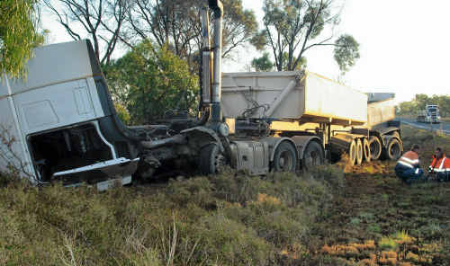 The wreckage of the B-double lies at the side of the Peak Downs Hwy after a crash early yesterday morning, about 45km north of Clermont.