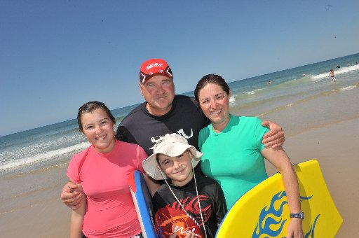 Mark and Jo Rogers with their children Sami, 11 and Ben, 9.