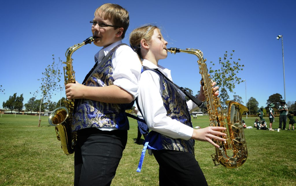 Year 7 concert band members Thomas Kleeman and Francesca Horchner from Highfields State School try out a tune in the park.