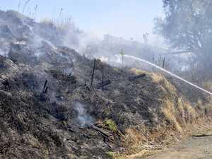 Grass fire threatens property