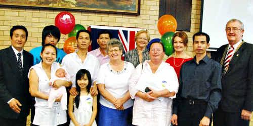 Peter, Miiti, Kathy (baby) and Khan Nggyen,Sue Bird, Lucille Burt, Duc Lo, Mayor Ron Dyne. Back: Huy and Lu Ngo, Quat Quang, Simonetta Tondinelli, Nur Harm.