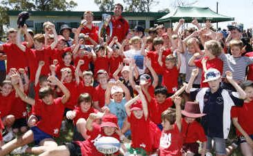 Queensland Reds Van Humphries and Ed Quirk with Central Highlands rugby juniors.