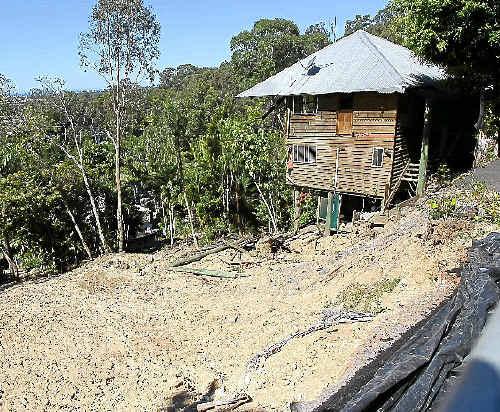 GOING GOING: Homes slide down the Buderim Mountain.