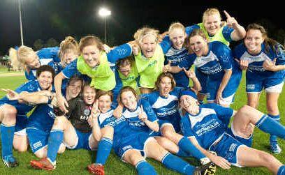 Woolgoolga Wildcats celebrate winning the women's grand final at BCU International Stadium.
