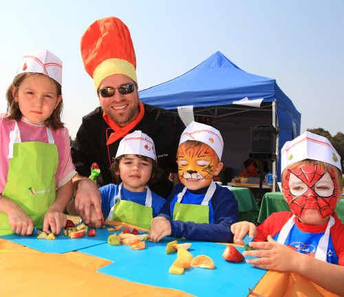 Elliesa Topping, Topaz Quarta, Harry and Charlie Williamson prepare a fruit salad using child-friendly knives.