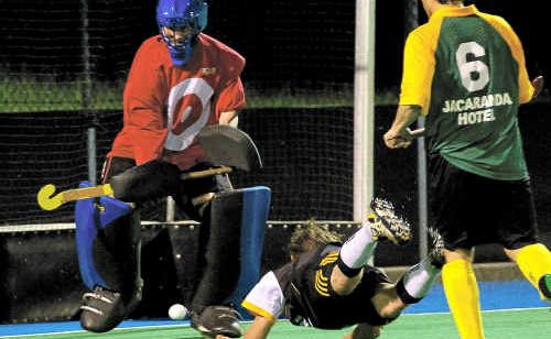 Barbarian Hagars' Troy Urquhart puts one between City Bears' goalkeeper Aiden Cameron's pads to open the scoring in the A-grade hockey final on Saturday night at Brett Livermore field.